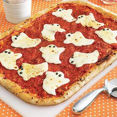 Ghostly Pizza  It is simple to make the ghoulish cheese shapes, just ask the clerk at the deli counter to slice your cheese about ¼ inch thick and use a Halloween cookie cutter.