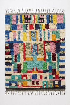 Blocked Abstraction Rug - anthropologie.com  Inspired by an ancient Moroccan technique, recycled fabric bits are hand-woven and knotted into a one-of-a-kind piece called a boucharouette, or rag rug.      Wool, cotton     Professionally clean     5' x 7'     Imported (no longer available)