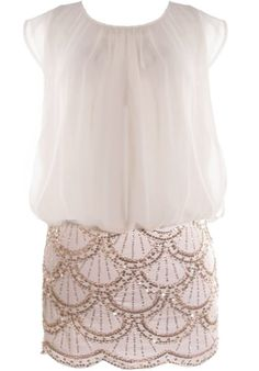 Eloquent chiffon and glitzy sequins capture the decade of opulence perfectly for our freedom-loving flapper girls! Features an airy chiffon bodice defined by beautiful drapery, tonal liner for full coverage, slitted sides and keyhole closure at nape, and a brilliant white skirt covered with gold sequin scalloped lines to finish. Pair with white platforms and a sparkling clutch to complete the look! $160.00