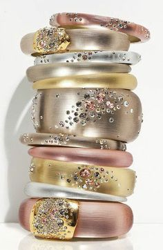 Would be easy to recreate this look with wooden bangles, metallic acrylic paint, rhinestones, & some E6000