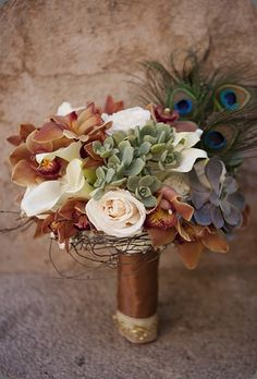 amazing color palette. i've used bleached peacock feathers in the past and they'd look amazing in a similar bouquet.
