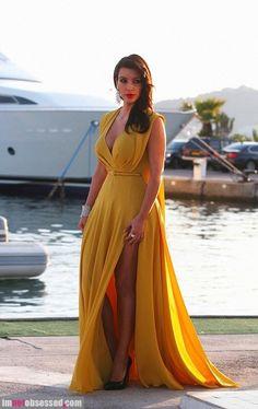 Kim Kardashian in yellow mustard colour evening gown dress
