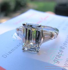 3.01 Emerald cut J VS2 with tapered baguettes