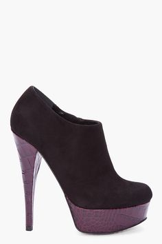 Suede ankle boots in black. Smooth croc embossed leather trim at base in dark purple. Almond toe. Zip closure at inner side. Tapered stiletto heel. Tonal stitching.