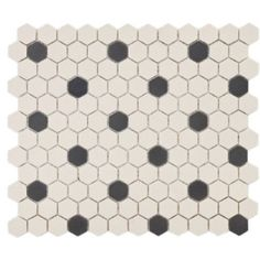 Looking for a classic floor tile for your bathroom? We love the black and white dot pattern of this hexagonal tile!