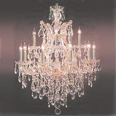 This gorgeous antique crystal chandelier by Maria Theresa provides an air of elegance to any home decor. This exquisite chandelier has 13 lights crafted on two tiers and features dazzling crystals draping down over the gold-tone Crystal Chandelier Lighting, Chandelier Lamp, Gazebo Lighting, Crystal Lamps, French Chandelier, Luxury Chandelier, Black Chandelier, House Lighting, Lights