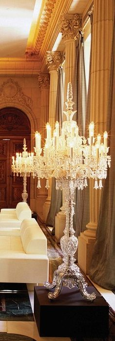 Palatial window columns and ornate crystal chandelier.