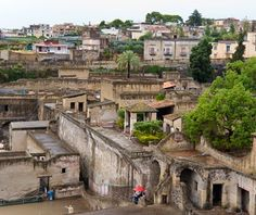 Herculaneum, Italy.Better preserved than nearby Pompeii, this onetime Roman resort town's excavated public baths, storerooms, upscale homes, and villas create a dramatic 3-D picture of life in A.D. 79, when Mount Vesuvius covered the town with a pyroclastic flow of volcanic mud 65 feet deep. The 760-degree mud charred but preserved wooden doors and roof-timbers and quickly encased iron-grill windows, grand marble fountains, and vividly detailed frescoes and mosaics.