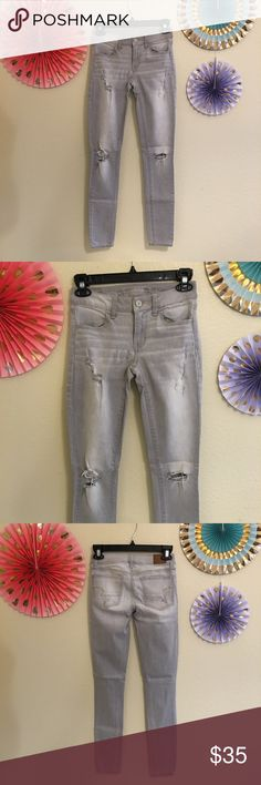 AE Jeans Super stretch distressed jegging. Light gray in color with fading. Great fit. Vintage collection. Very soft. American Eagle Outfitters Jeans