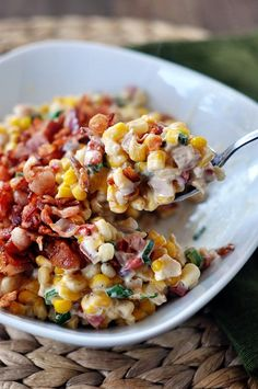 "Confetti corn recipe. ""This dish can be made up to 2 days ahead of time. Scoop the creamy corn mixture into an oven-safe dish, sprinkle with the bacon and cover with a lid or plastic wrap. Store in the refrigerator. When ready to eat, heat the corn dish in a 325 degree oven for 15-20 minutes until heated through."""