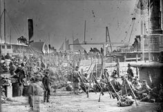 """Embarkation of 9th Army Corps for Fort Monroe    This photograph is by Alexander Gardner. """"On February 5, 1863, Sedgwick was succeeded by Maj. Gen. William F. """"Baldy"""" Smith, and on February 12 the corps was ordered to Newport News, where it encamped for a month."""" [IX Corps (Union Army) – Wikipedia]"""