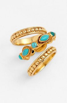 Stack and layer gold with turquoise .