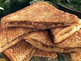 Paula's Fried Peanut Butter and Banana Sandwich (saw this flipping through the channels!) i've tried PB and banana's sandwiches just not fried!! :)