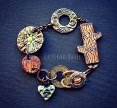Leather cord  Pewter signature button- Mamacita Beadworks  Resin branch- Jade Scott  pewter ring- Dorabeth Designs  Ceramic Flower connector-