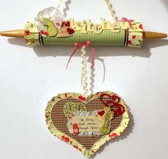 idea for altered rolling pin - this could be cute for a hanging recipe holder