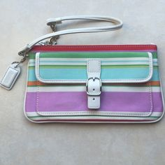 Authentic Coach Multi-Colored Wristlet Authentic Coach Multicolored Wristlet with silver hardware.  Front button closure reveals a pocket for ID's, etc.  Lime green Interior.  Great on the go Wristlet! Like new, never used, without tags. Coach Bags Clutches & Wristlets
