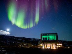 Aurora borealis over Hotel ION located by Nesjavellir Power Plant, Iceland…