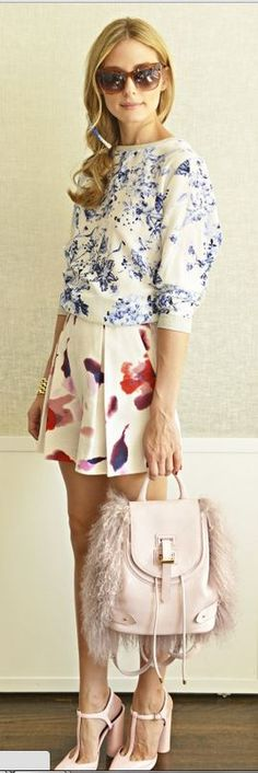 Who made Olivia Palermo's blue floral top, water color shorts, feather back pack, brown sunglasses, and pink t pumps?