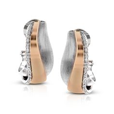 Contemporary and bold, these earrings combine 18k white and rose gold together with .24 ctw of white round diamonds.
