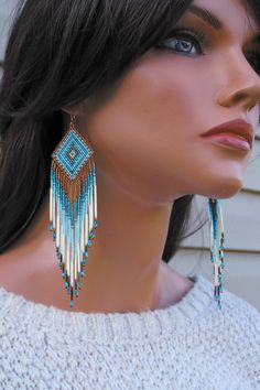 Hey, I found this really awesome Etsy listing at https://www.etsy.com/listing/106093480/seed-bead-quill-earrings-swarovski-and