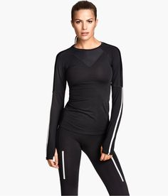 Black fitted long-sleeved running top with functional fabric, cuff thumbholes, and reflective details. | H&M Sport