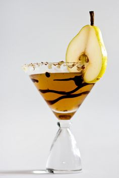 Pears Hélène Martini...•2½ ounces pear nectar   •2 ounces vanilla vodka   •½ ounce coffee liqueur   •¼ ounce fresh lemon juice   •chocolate syrup, garnish   •sliced almonds, garnish   •pear slices, garnish