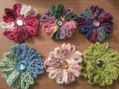 Crochet daisies! G crochet hook. Ch 4; join with sl st Ch 2 up. Sc 9 more in ring. Join with sl st. Ch 7 up: join in same stitch ★(ch 7 up; join w/ sl st in next st...ch 7 up; join in same st) Repeat from ★ around. Makes 20 petals. Pull string thru to back and tie off with starting string. Awesome!