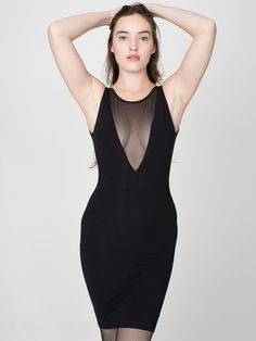 41558a4693 Sleeveless Gloria-V Dress Sexy mini tank dress featuring a plunging mesh  neckline and scoop back