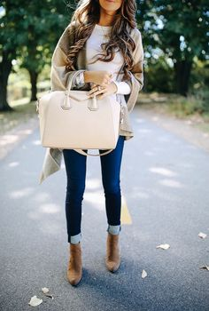 check woven poncho  // white ribbed top // Givenchy Antigona handbag   wedge booties // similar dark wash jeans  // Prada s...