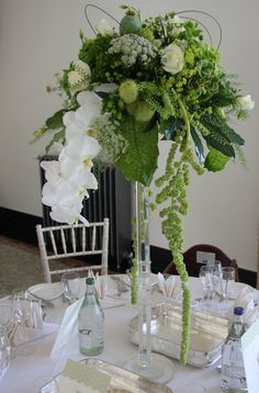 Flower Design Events: Crystal Candlestick table Design in Green Shades for a Wedding Day at The Leverhulme Hotel, Port Sunlight
