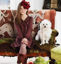 girl and dog sitting on a couch