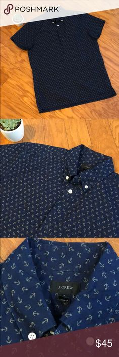 Men's J Crew Pull Over Button Up Shirt Men's J. Crew Pull Over Button Up Shirt in navy with anchors. In new condition and never worn. Bottoms on front of shirt are like a polo and do not go all the way down the front of the shirt. J. Crew Shirts Casual Button Down Shirts