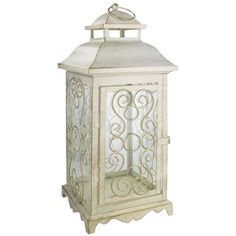 """Elegantly display your favorite scented or LED candle while accenting decor with this Antique White Metal Lantern. The lantern is accented with tints of gold.    Dimensions:      Length: 15 3/4""""    Width: 6 3/4""""    Depth: 6 1/4"""""""