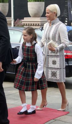 Ten years old Norwegian Princess Ingrid Alexandra with her mother Crown Princess Mette-Marit, on her first official visit to the Parliament (Storting) in Oslo on 15.05.2014 for the special ceremony for the bicentenary of the Norwegian Constitution.