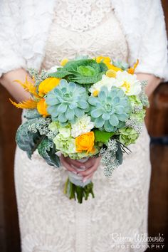 A succulent inspired bouquet of local organically grown succulents, local kale, celosia, ranunculus, lambsear and other accents for a lovely Oakland wedding.  Photo by Rebecca Wilkowski www.rebeccawilkowski.com/
