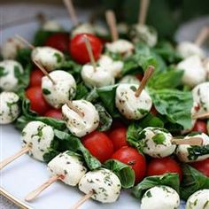 Tomato and Mozzarella Bites         20 grape or cherry tomatoes, halved      20 fresh basil leaves      20 small balls fresh mozzarella cheese (often labeled bocconcini)      salt and pepper to taste      1/2 cup balsamic vinegar      1/4 cup extra virgin olive oil      20 toothpicks