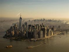 Cheers erupt as spire tops One World Trade Center