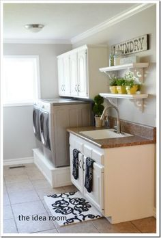Laundry room decor and raised washer and dryer