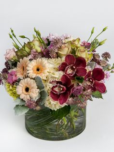 Garden Luxe This deluxe arrangement is the look of luxury. Made in tones of cream, green, and wine red, this arrangement includes gorgeous blooms such as hydrangea, roses, and orchids. #robertsonsflowers