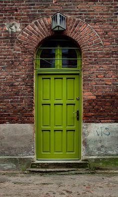 Old green wooden in Łódź, Poland. I love the color of this door, and of course this red brick wall. My favorite! Door Entryway, Entrance Doors, Doorway, Front Doors, Cool Doors, Unique Doors, When One Door Closes, Door Gate, Door Knockers