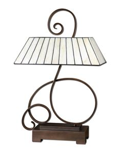 I absolutely love the graceful lines on this gorgeous lamp. The curved metal is finished in a lightly distressed oil rubbed bronze finish. The rectangular shade is honey ivory Tiffany style art glass.