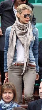 Bar Refaeli in a denim jacket, tan pants, belt, pink bag