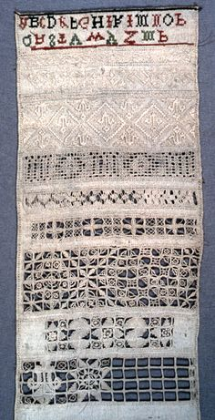 "Part of an unfinished white work sampler. Bands of pattern: open work followed by solid all white. At bottom alphabet in red and green.    This sampler is medium: silk and linen embroidery on linen foundation technique: embroidered in long armed cross, satin, overcasting variation, and withdrawn elements with needlemade fillings (reticella) on plain weave foundation. Its dimensions are: H x W: 43 x 18.7cm (16 15/16 x 7 3/8in.).    It is inscribed ""M. P."".    This sampler is from United…"