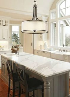Traditional kitchen with drum shade chandelier