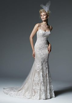 Sottero and Midgley gown with sheath silhouette, tulle skirt, beadwork, and embellished lace I Style: Celine I https://www.theknot.com/fashion/celine-sottero-and-midgley-wedding-dress?utm_source=pinterest.com&utm_medium=social&utm_content=june2016&utm_campaign=beauty-fashion&utm_simplereach=?sr_share=pinterest