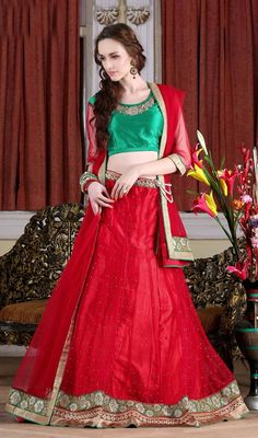 Influence a fresh adulation and sparkle to your individualism adorned in this red color embroidered net choli skirt. The appealing lace and resham work a substantial attribute of this attire. Upon request we can make round front/back neck and short 6 inches sleeves regular choli blouse also. #TraditionalCollectionOfLehengaCholi