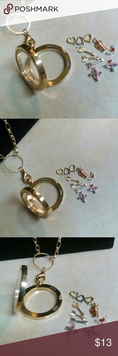Love/Cupid's Arrows Living Memory Locket Brand New definitely. It's true love with Cupid's arrows. As they say.... love is in the air :) I'm a sap when it comes to True love. This is a beautiful piece for ur necklace collection. Jewelry Necklaces