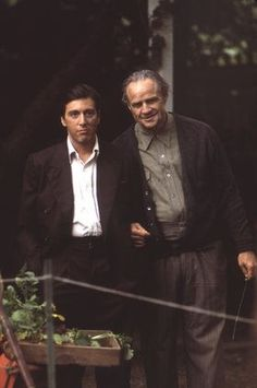 The Godfather: Michael Corleone (Al Pacino), Don Vito Corleone (Marlon Brando). Based on the novel by Mario Puzo, The Godfather is one of Hollywood's most successful films of the Marlon Brando Children, Marlon Brando Wife, Brando Godfather, Marlon Brando Movies, Marlon Brando James Dean, Godfather Movie, Godfather Series, Cinema Tv, Films Cinema