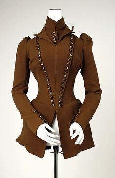 Brown wool bodice with pointed lapels, by B. Altman & Co. American, ca. 1891. Part of a matching ensemble, with brown velvet and wool cap, and double-breasted brown wool jacket.