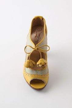 OH my gosh! I have been looking for mustard cute heels for over a year now...look at these beauties!!
